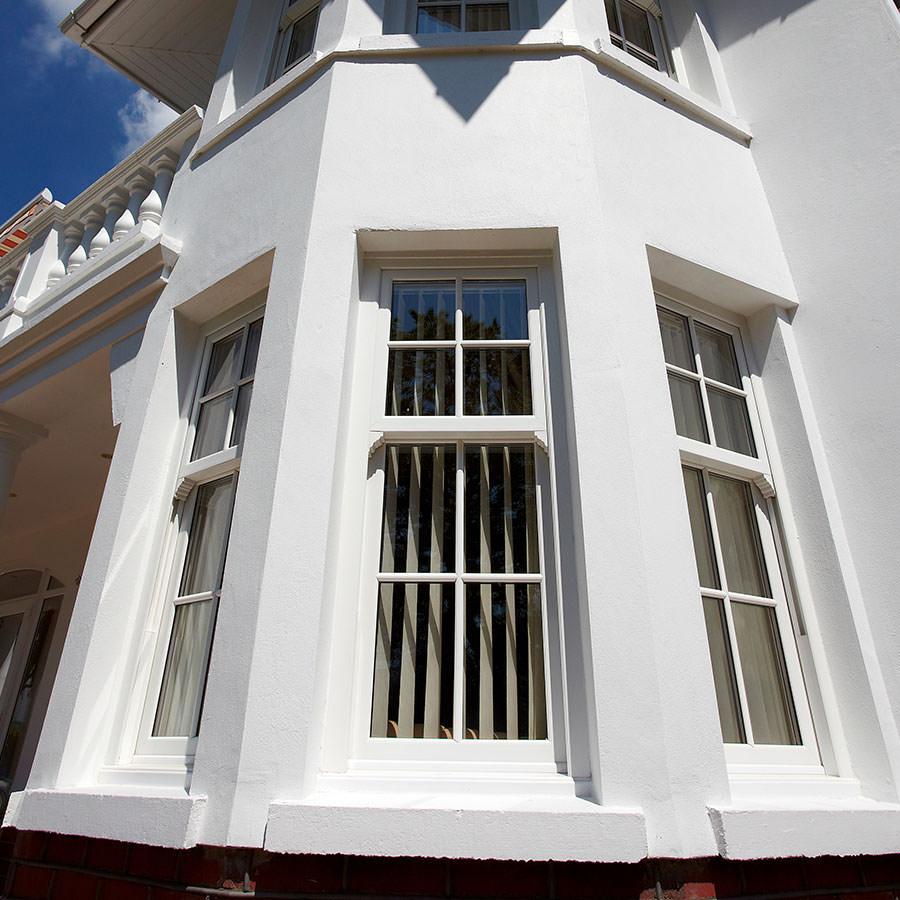 White uPVC sash windows in a bay