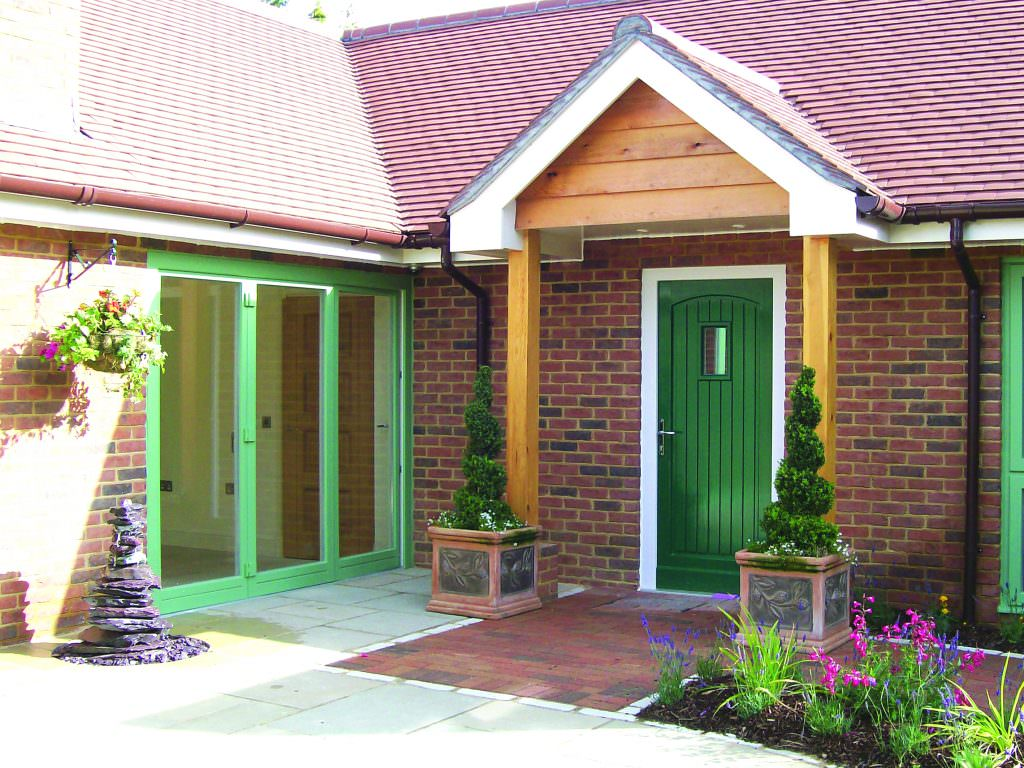 Chartwell green bi-folding sliding doors