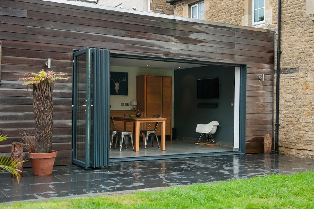 Grey aluminium bi-folding sliding doors